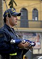 US Navy 080615-N-7797J-028 A member of Peru's national police force prepares to hoist the United States National Ensign during a ceremony that marks the end of Continuing Promise (CP) 2008 opertations in Peru.jpg