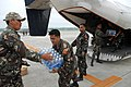 US Navy 080627-N-0640K-190 Service members assigned to the Philippine Army load a C-2A Greyhound with supplies from the Nimitz-class aircraft carrier USS Ronald Reagan (CVN 76) at Iloilo Airport.jpg