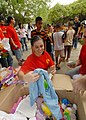 US Navy 080913-N-9079D-044 Yeoman 3rd Class Margret Ueberlauer hands out toys to HIV infected children during a community relations project at the Camillian Center in Pattaya, Thailand.jpg