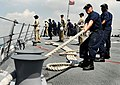 US Navy 090424-N-9928E-088 Sailors heave a mooring line on the forecastle aboard the Arleigh Burke-class guided-missile destroyer USS Kidd (DDG 100) as the ship moors pier side.jpg