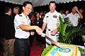 US Navy 090514-N-1488S-067 Commanding Officer of Arleigh Burke-class guided missile destroyer USS Kidd (DDG 100), Cmdr. Chuck Good, participates in a cake cutting ceremony with Chief of Republic of Singapore Navy, Rear Adm. Che.jpg