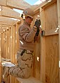 US Navy 091207-N-9564W-056 Construction Electrician 2nd Class Alyssa Copp installs rough-in electrical wire for a 20-foot by 32-foot Southwest Asia hut.jpg