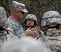 US Navy 100322-N-6932B-394 Lt. Cmdr. Raul Barrientos listens as Staff Sgt. David Garland, an Army drill instructor, critiques a convoy training evolution during the U.S. Navy Individual Augmentee Combat Training course at Fort.jpg