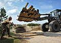 US Navy 100518-N-0000C-001 Builder 3rd Class Justin O'Donnell guides Equipment Operator 3rd Class Zachary Bunter as he operates a caterpillar 924G bucket loader.jpg
