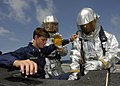 US Navy 100720-N-3154P-090 Sailors simulate rescuing a pilot from a downed helicopter during an at-sea fire party training scenario aboard the amphibious transport dock ship USS Ponce (LPD 15).jpg