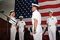 US Navy 100729-N-5446H-146 Rear Adm. Nora W. Tyson salutes Capt. Jeffrey A. Hesterman during a change of command ceremony in the hangar bay aboard USS George H.W. Bush (CVN 77).jpg
