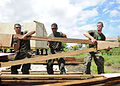 US Navy 101023-N-1531D-018 Marines assigned to Special Purpose, Marine Air Ground Task Force lift roof framing for a storage building during a Cont.jpg
