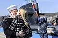 US Navy 110302-N-8467N-003 Electronics Technician 3rd Class Christopher Shepardpearson receives the traditional first kiss from his wife after the.jpg