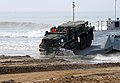US Navy 110304-N-1786N-016 A Marine drives a medium tactical vehicle replacement vehicle onto the beach during roll-on-roll-off discharge facility.jpg