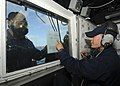 US Navy 110519-N-YM590-053 Damage Controlman 3rd Class Adam W. Bailey shows contamination results to Quartermaster 3rd Class Joseph P. Gregory duri.jpg