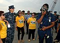 US Navy 110630-N-NJ145-111 Damage Controlman 3rd Class Yahaila Hernandez demonstrates a self-contained breathing apparatus to Philippine Navy sailo.jpg