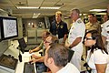 US Navy 110722-N-MV421-002 Andy Cairns shows Chief of Naval Operations (CNO) Adm. Gary Roughead components of the DDG 1000 integrated power system.jpg