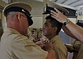 US Navy 110916-N-RQ668-116 Chief Electrician's Mate Jarad Big has his chief's anchors pinned on and is presented his chief petty officer combinatio.jpg