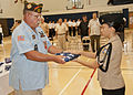 US Navy 111103-N-AZ907-004 William Bradford passes a flag to a Guam High School Navy Junior ROTC cadet during a flag retirement ceremony at the hig.jpg