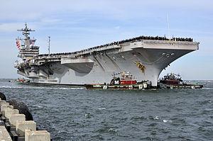 US Navy 111210-N-FU443-612 Sailors aboard the USS George H.W. Bush man the rails.jpg