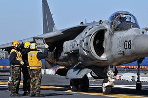 US Navy 120119-N-UM734-820 Aviation boatswain's mates show flight information to AV-8B pilot Marine Corps Capt. J.T. Widmyer, assigned to Marine At.jpg