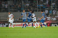 Valais Cup 2013 - OM-FC Porto 13-07-2013 - Choc entre Dimitri Payet et Jackson.jpg