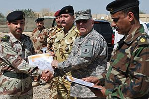 Francis D. Vavala - Maj. Gen. Frank Vavala presents an Iraqi army graduate of the Baghdad Signal University his diploma upon graduation at Camp Victory, Baghdad, Iraq, in 2009. (U.S. Army photo by 1st Lt. Mike Crilley.)