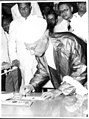 Vice President S. Radhakrishnan signing the Golden Book on arrival at the Ratmalana Airport in Colombo.jpg