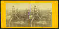 View of a house under construction, showing men finishing the chimney, from Robert N. Dennis collection of stereoscopic views.png