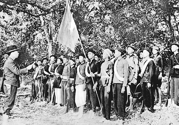 Vo Nguyen Giap (left) together with Viet Minh forces in the jungle near Kao Bak Lang in 1944 Vo Nguyen Giap, Vietminh forces, 1944.jpg