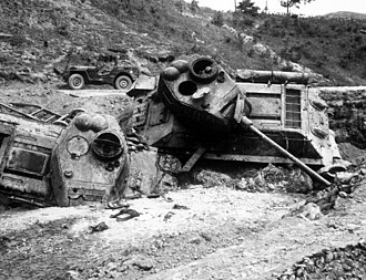 First Battle of Naktong Bulge - North Korean T-34 tanks destroyed by US Air Force bombs near Waegwan.