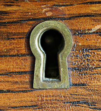 Keyhole - A traditional keyhole for a warded lock.