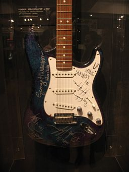 Traveling Wilburys signed guitar