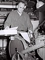Willard D Morgan working in home print shop, 1950.jpg