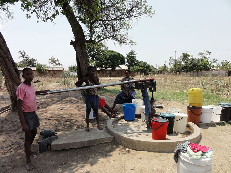 Women and children at a borehole.jpg