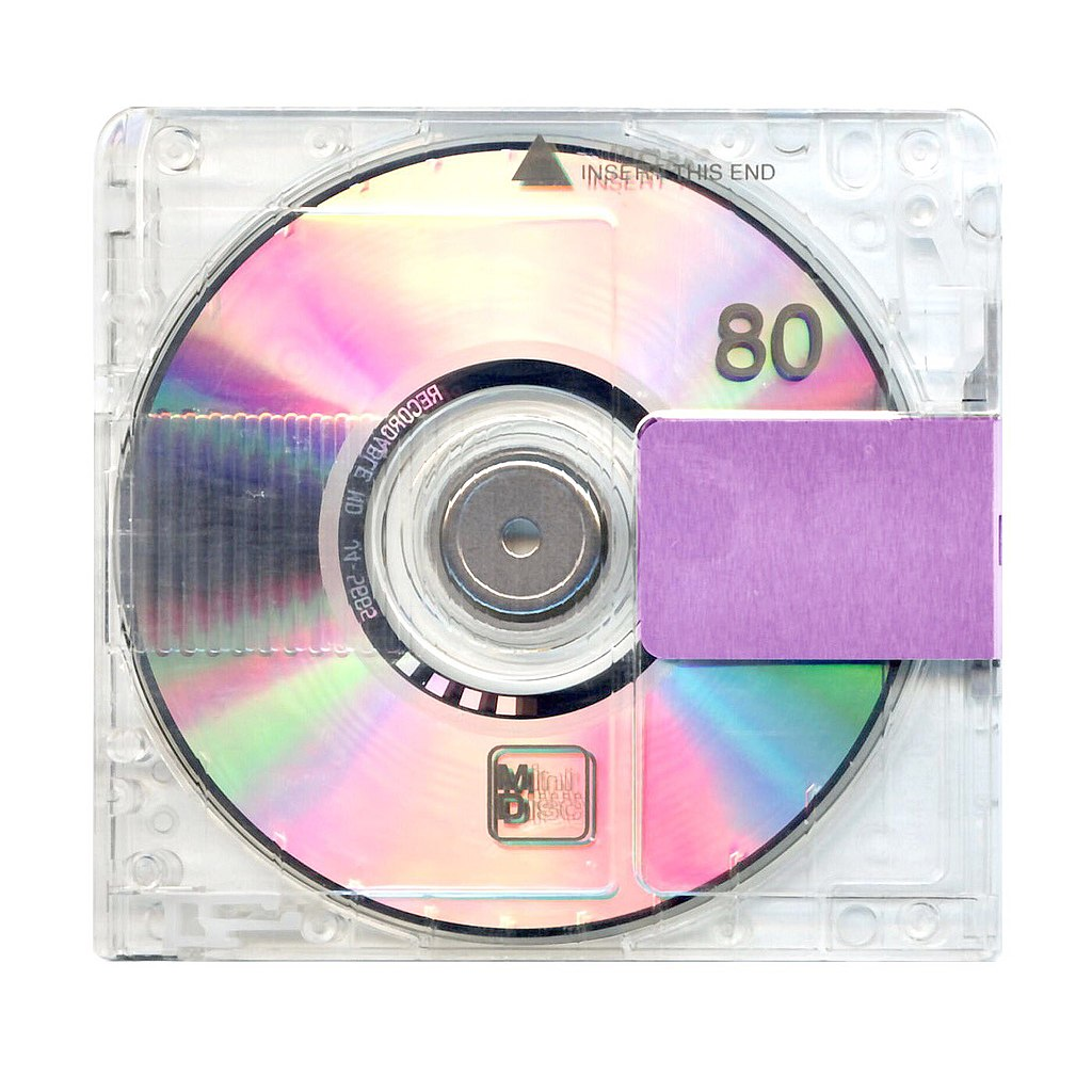 Cover art for Yandhi, which features a MiniDisc enclosed in a clear case, sealed off with purple tape