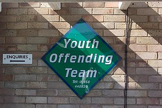 Youth offending team - Logo of the youth offending teams outside a Somerset YOT Office.