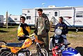 (Hurricane Katrina) Baker, LA December 25, 2005 - Holden Sylve, Cardez White, and Corey Zite compare their Christmas motorbikes at the trailer home park where they've been living si - DPLA - a7c58eaf8fdb110a06d71d6ddf5ef9e3.jpg