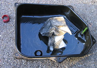 Automatic transmission fluid - Oil pan of an automatic transmission with sedimented wear