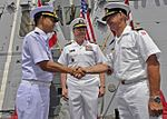 1200329-N-AZ513 Rear Adm. Tanin Likitawong, left, relieves Royal Danish Navy Commodore Aage Buur Jensen.jpg