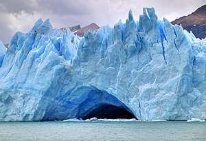 Glacier cave - A partly submerged glacier cave on Perito Moreno Glacier. The ice facade is approximately 60 m high