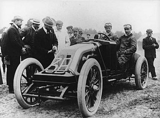 1906 French Grand Prix - J. Edmond in his Renault before the race. He retired after melting tar from the road surface seeped past his goggles and into his eyes.