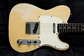 Telecaster body, showing absence of contouring and general symmetry apart from cutaway, two single-coil pickups and controls