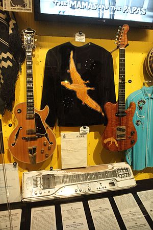 Sneaky Pete Kleinow - The nudie suit worn by Kleinow on the cover of 1969's The Gilded Palace of Sin, along with his Fender 400 pedal steel guitar, displayed at the Rock and Roll Hall of Fame in Cleveland.