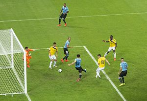 James Rodríguez - James scoring his second goal against Uruguay in the Round of 16 match.