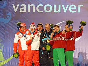 Biathlon at the 2010 Winter Paralympics – Men's pursuit - From left to right: Andrey Tokarev (guide) and Nikolay Polukhin of Russia (silver), Volodymyr Ivanov (guide) and Vitaliy Lukyanenko of Ukraine (gold), and Vasili Shaptsiabol and his guide Mikalai Shablouski of Belarus (bronze).