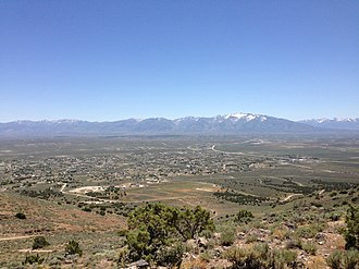 "Spring Creek, Nevada - View of Spring Creek from ""E"" Mountain, with the Ruby Mountains in the background"