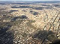 2016-03-18 16 42 00 View of Washington, DC from an airplane departing Ronald Reagan Washington National Airport, with the P Street Bridge over Rock Creek at the center.jpg