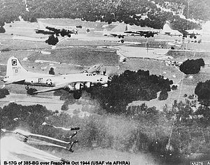 "385th Air Expeditionary Group - B-17s of the 385th Bomb Group on a parachute drop over France, October 1944. B-17G ""Dozy Doats"" visible in foreground."
