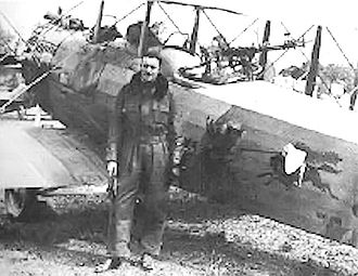 91st Aero Squadron - Major John Reynolds, commander of the 91st Aero Squadron, standing next to his Salmson 2A2 with the Squadron Emblem painted on the side of his aircraft, Gondreville-sur-Moselle Aerodrome, France, 1918