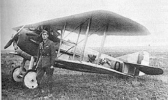 91st Cyberspace Operations Squadron - 1st Lt. Everett R. Cook, Commanding Officer, 91st Aero Squadron, standing beside his Spad VIII aircraft, 1918