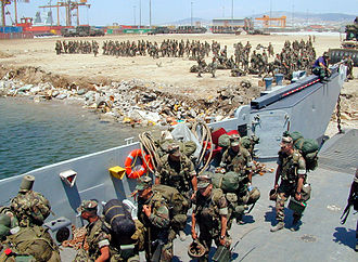 Marine expeditionary unit - Marines loading on a Landing Craft Utility in 1999