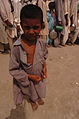 A Pakistani boy waits for aid at an internally displaced person settlement Aug. 25, 2010, in Pakistan 100825-A-KI401-030.jpg