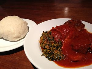 Egusi sauce - Egusi soup atop a dish, with pounded yam (upper-left)