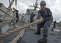 A Sailor mans a line aboard USS Fort Worth. (16406382439).jpg